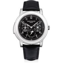 PATEK PHILIPPE - A very fine and very rare platinum minute repeating perpetual calendar wristwatch with moon phases, 24 hours, leap year indicator, additional case back, original certificate and fitted presentation box, Circa 2009
