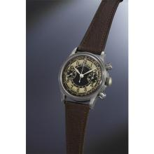 OMEGA - An extremely rare, highly attractive and large stainless steel chronograph wristwatch with glossy black dial, luminous hour marker track, tachometer and telemeter scales, 1945