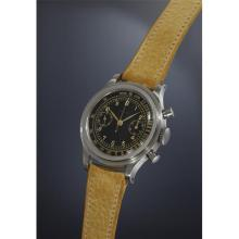 LONGINES - A very rare and attractive stainless steel fly-back chronograph wristwatch with black lacquered dial and gold-colored tachometer scale., 1943