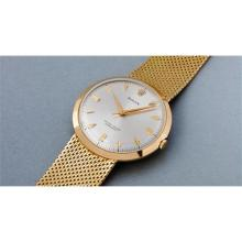 ROLEX - A very attractive, well preserved, and large yellow gold center seconds wristwatch with integrated mesh bracelet, 1957