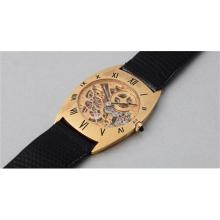 AUDEMARS PIGUET - An extremely rare tonneau shaped yellow gold hand skeletonized ultra-thin wristwatch with black enameled Roman numerals and presentation box, 1968