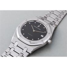 AUDEMARS PIGUET - A very rare, large and heavy white gold wristwatch with diamond hour-markers, date and bracelet, 1977