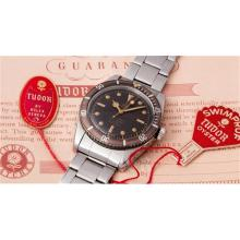 TUDOR - A very attractive stainless steel wristwatch with tropical dial, bracelet, blank guarantee, box and hangtags, 1958