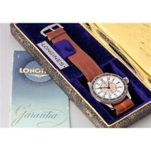 LONGINES - A fine, very rare and historically interesting oversized steel aviator?s hour angle wristwatch with enamel dial, center seconds and original box, 1936