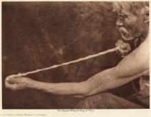 Edward S. Curtis: Measuring Shell Money — Tolowa, From The North American Indian, Volume 13, 1923, photogravure,