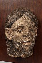 Tête de Christ ou d'Apôtre en pierre calcaire sculptée en haut relief et polychromée