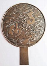 A Large Chinese Bronze Mirror the back decorated w