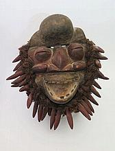 An African Mask with metal teeth, c. 40cm