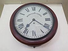 A Devon County Council Mahogany Cased Wall Clock w