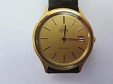 An Omega De Ville in gold plated case with quartz