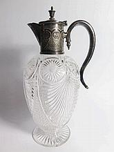 A Cut Glass Claret Jug with silver plated mounts a