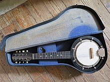 An Early 20th C. Banjolele in case, together with