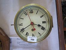 A Brass Cased Ship's Clock, 6in. dial