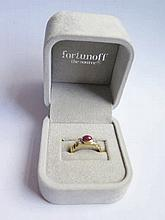 A Fortunoff 14k Gold Cabouchon Ruby and Diamond Ri