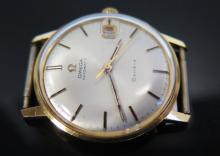 An Omega 18ct Gold Automatic Gent's Waterproof Wristwatch with date apertur