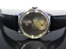 An Omega Manual Gent's Wristwatch with mirror finish dial and subsidiary se