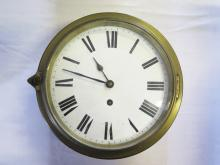 A Brass Cased Ship's Clock with enameled dial and French platform escapemen