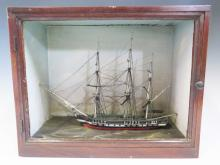 A Nineteenth Century Model Three Masted Ship in Mahogany Case, case measure
