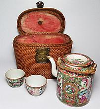 A Nineteenth Century Chinese Cantonese Export Ware Tea Pot with two matching tea bowls in original case