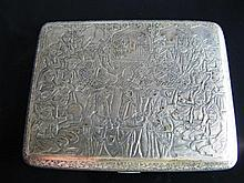 An Eastern Silver Cigarette Case finely chased