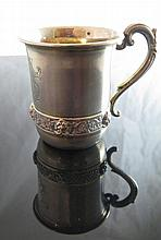 A German Silver and Gilt Cup decorated with masks,