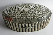 A Continental Silver Box with chased scrolling