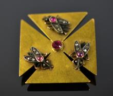 14K Gold  Pin with Rubies and Diamond.