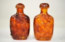 Two Carved Amber Snuff Bottles
