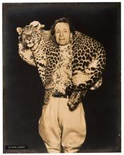 Three Photographs of Animal Trainer Alfred Court. Various dates and publishers, ca. 1940s. One portrait (mounted on board) and two photo-montages of Alfred Court, French acrobat and animal trainer, with various predator animals. 11 x 14?. Very good.