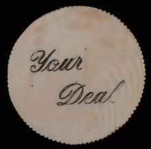 "Ivory ""Your Deal"" Poker Buck With Milled Edge. American, ca. 1890. The button was placed in front of the dealer who is then last to act in the rounds of betting to follow. Such pieces of this era are rarely seen. Excellent. Seymour 366. With: a copy of Antique Gambling Chips (1998).*"