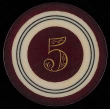 """Five Dollar Ivory Poker Chip. American, ca. 1890. Five dollar ivory poker chip in two concentric circles with outside rim, edge and middle tinted purple, a color infrequently encountered on ivory chips. 1 3/8"""" diam. Excellent."""