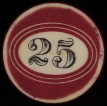 """Twenty-Five Dollar Ivory Poker Chip. American, ca. 1890. Twenty-five dollar white ivory poker chip surrounded by two concentric red oval circles, with red rim. 1 ½"""" diam. Excellent."""