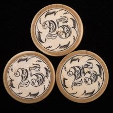 """Three Twenty-Five Dollar Ivory Poker Chips. American, ca. 1890. Demonization encircled within leaves. Green rim. 1 ½"""" diam. Very slight cracking on rims from moisture loss and age, otherwise excellent."""