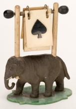Elephant Trump Indicator. Circa 1930. Elephant stands on celluloid base. Both sides of celluloid markers have suit symbols. Excellent.