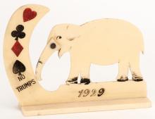 Elephant Trump Indicator. 1929 Celluloid elephant whose trunk indicates suit.