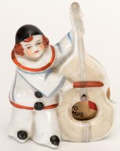 Trump Indicator Clown Playing Bass Violin. Circa 1930. Porcelain figure of clown playing bass violin. Made in either Japan or Germany. Excellent.