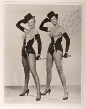 Monroe, Marilyn and Jane Russell. Promotional Photo Signed by Jane Russell. Circa 1953. Promotional photo for Gentlemen Prefer Blondes (1953), starring Marilyn Monroe and Jane Russell. Boldly inscribed and signed on upper right hand corner by Jane Russell. 8 x 10