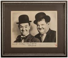 Laurel and Hardy Inscribed and Signed Photo. Vintage studio portrait of the duo, boldly inscribed and signed in the white space below the image in blue ink by both stars: 'Our Best Wishes Always To Mr. and Mrs. Panoff  Sincerely -! Stan Laurel, Oliver Hardy.