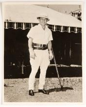 Clyde Beatty Inscribed and Signed Photograph. 1947. Depicts circus owner and impresario Clyde Beatty in safari gear standing in front of circus tent. Slightly faded inscription reads, 'To J. B. Bennett, Best Wishes, Clyde Beatty.