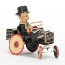 841. Charlie McCarthy in his Benzine Buggy Toy. New York, Marx, ca. 1930. Lithographed tin wind-up toy. 7