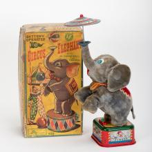 862. Circus Elephant Toy. Japan, Rosko-Steele, ca. 1950s. Battery operated toy. Litho tin and fabric. With orginal box (worn and torn). 9 _