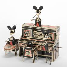 897. Marx Merrymakers Band. New York, Louis Marx, ca. 1929. Lithographed tin wind-up toy. Features four mice, two in band, one dancer, one seated conductor on top of piano. 9 x 8