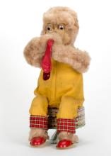 903. Balloon Blowing Monkey. Japan, Rock Valley Toys, ca. 1950. Battery operated toy. Litho tin base, cloth and fabric body. Monkey inflates a balloon. Yellow overalls. 11