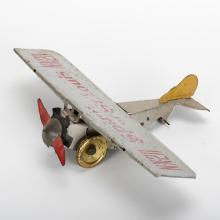 942. Spirit of St. Louis Toy. New York, Marx, ca. 1930. Tin wind-up toy model of Lindbergh's famous airplane. 9 _ x 13