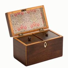 975. Antique Mahogany Tea Caddy. English, third quarter nineteenth century. Rich mahogany with secondary fruitwood structure. Inlaid bone key plate. Lidded interior compartments. Replacement paper lining interior, new felt padding on underside. Approx. 7 x 5 x 4 _ '. Lacking key. One strip of fruitwood chipped on lid.