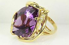 Amethyst and Diamond ring with Fancy shape Amethyst of 32.46ct and Diamonds totalling 0.10cts. 18ct yellow gold, ring size N - can only be resized up and down by a maximum of 5 sizes.