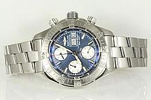 Breitling Superocean chronograph automatic stainless steel mens watch. Swiss Made, navy dial, day & date. With Breitling stainless steel bracelet and clasp. Model# A13340. With Breitling warranty booklet dated June 2006 inside box.