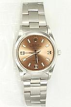 Rolex Oyster Perpetual Air-King Precision stainless steel automatic watch. Swiss Made, champagne dial. With Rolex bracelet and clasp. Case diameter: 34mm. Model# 14000. With certificate of authenticity and Rolex box.