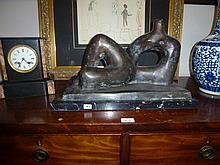 Recumbent Man, bronze sculpture
