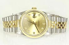 Rolex Oyster Perpetual Datejust 18ct yellow gold & stainless steel automatic mens wrist watch, gold dial, date, diamond indicators, Swiss Made. With two-tone Rolex bracelet and clasp. Model# 16233G. Case Diameter: 36mm. With Rolex certificate dated
